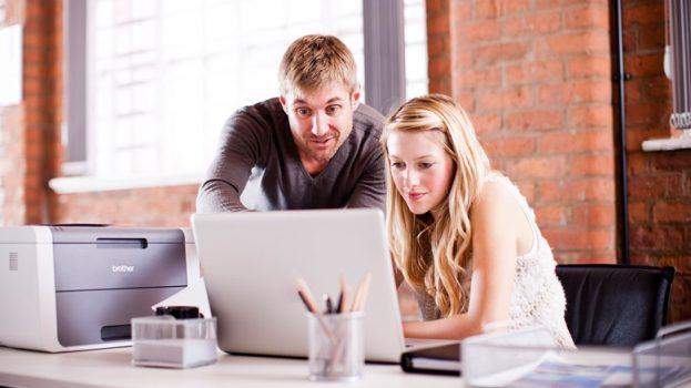 man-lady-working-together-laptop-bradmin-professional